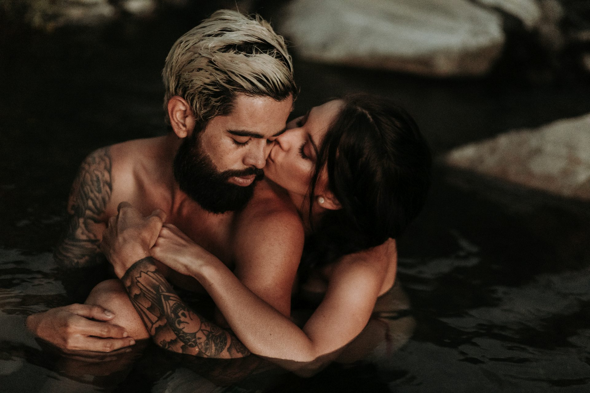 couple at hot spring during their hiking adventure wedding in Chile