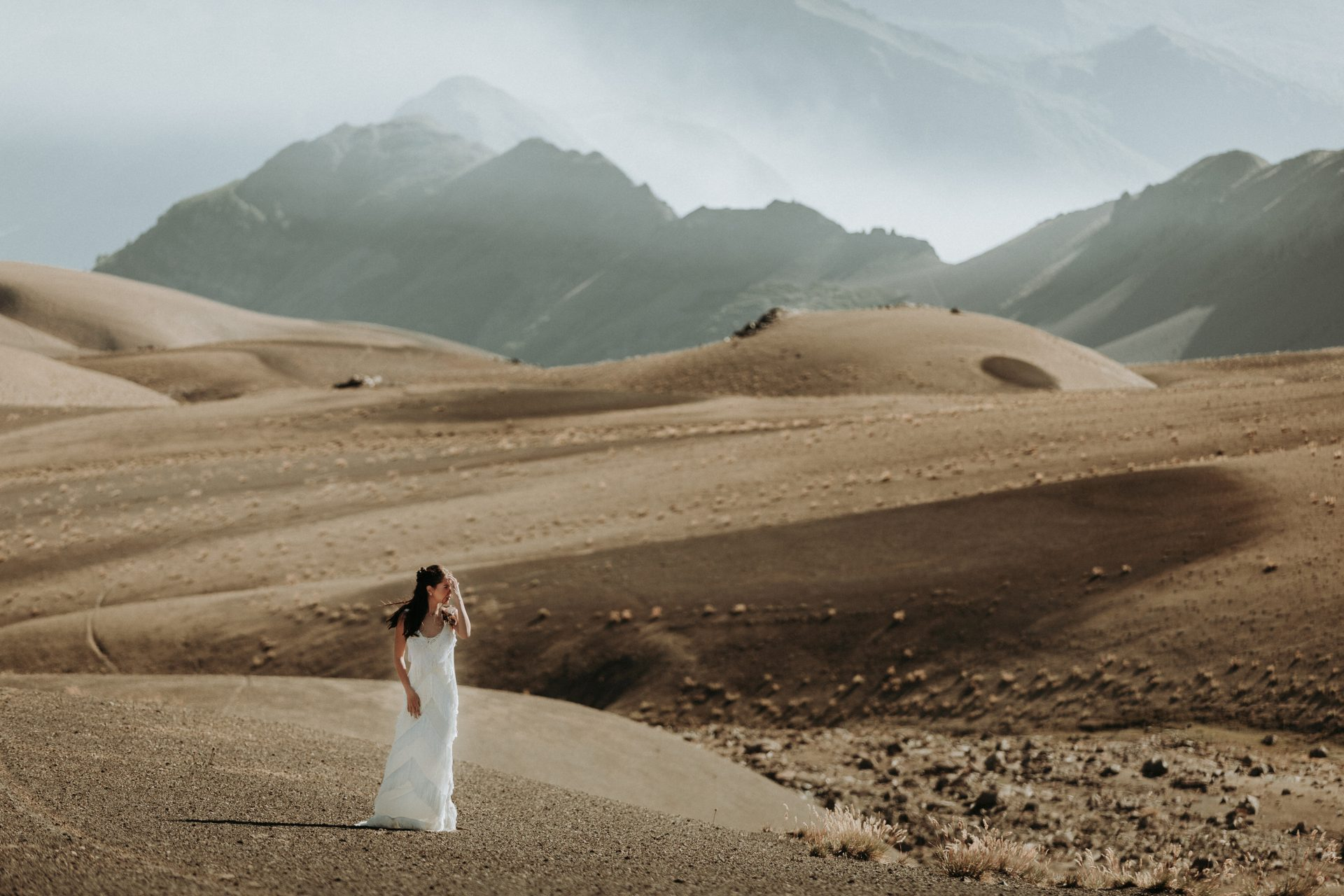 hiking adventure wedding in Chile - bride on mountain plateau