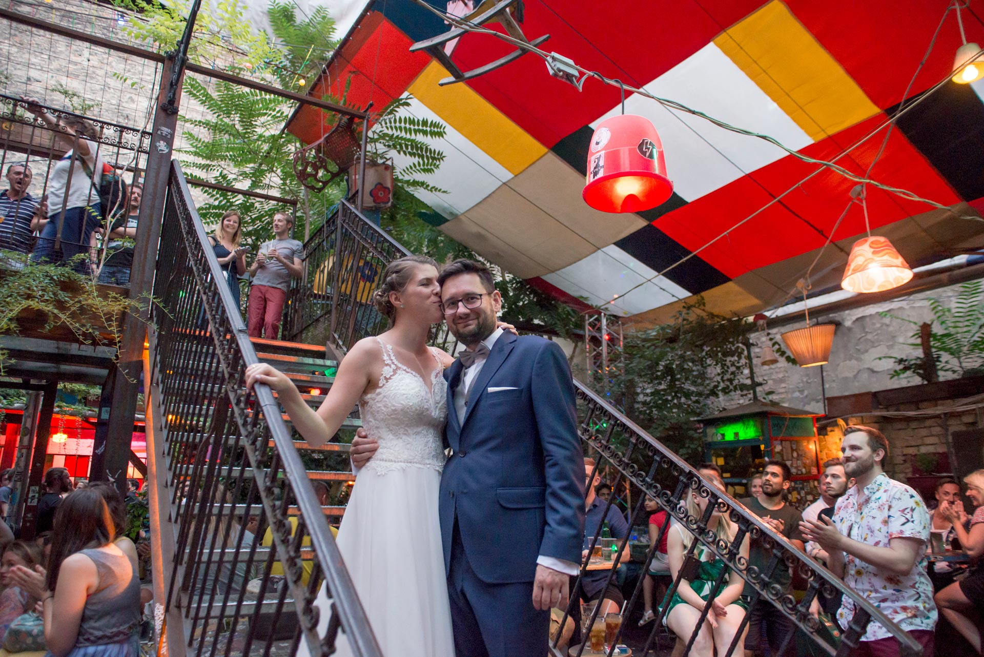 Adventure Wedding Location - Hungary, Budapest, buzzing nightlife, happy married couple inside a ruin bar