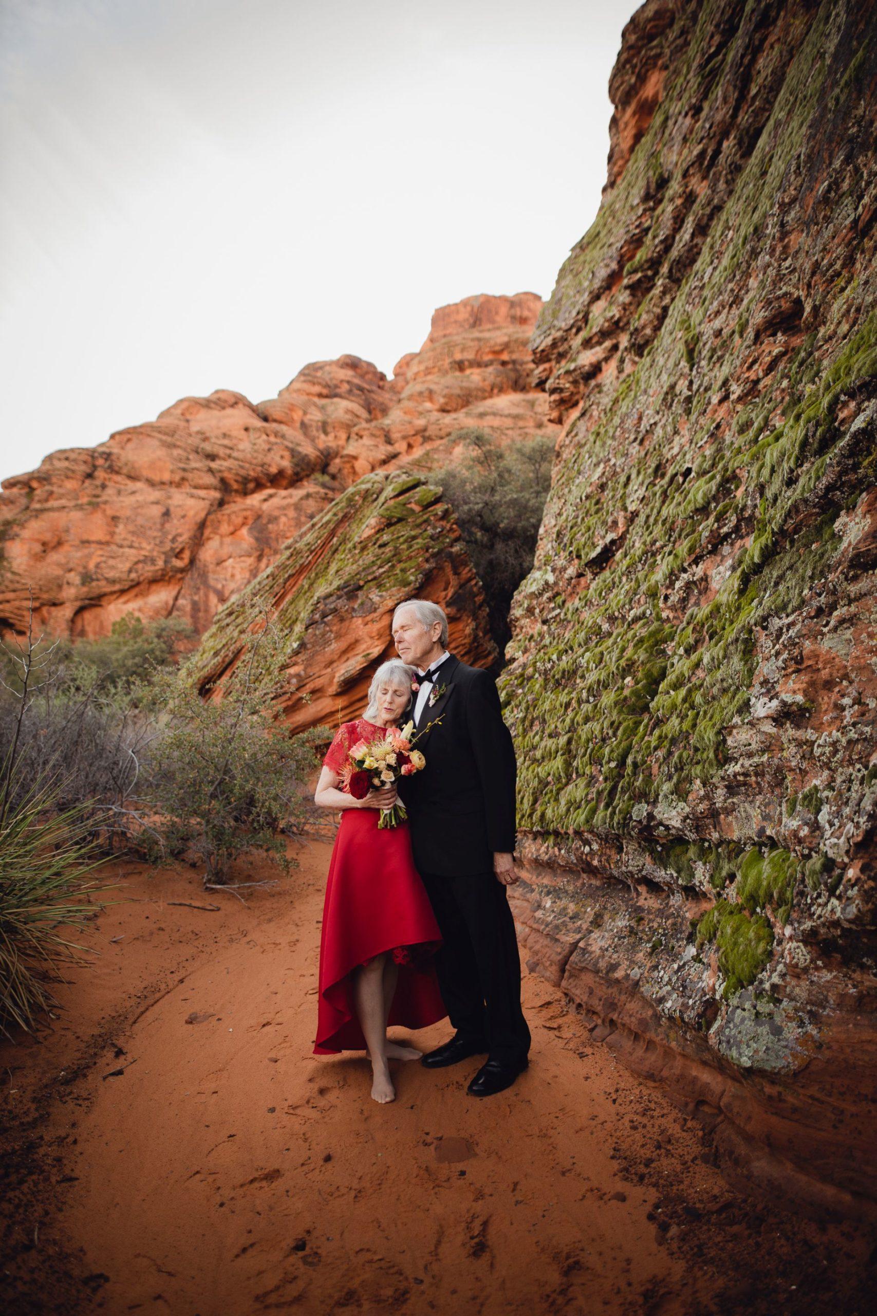adventure wedding desert utah - couple in intimate hug during their elopement