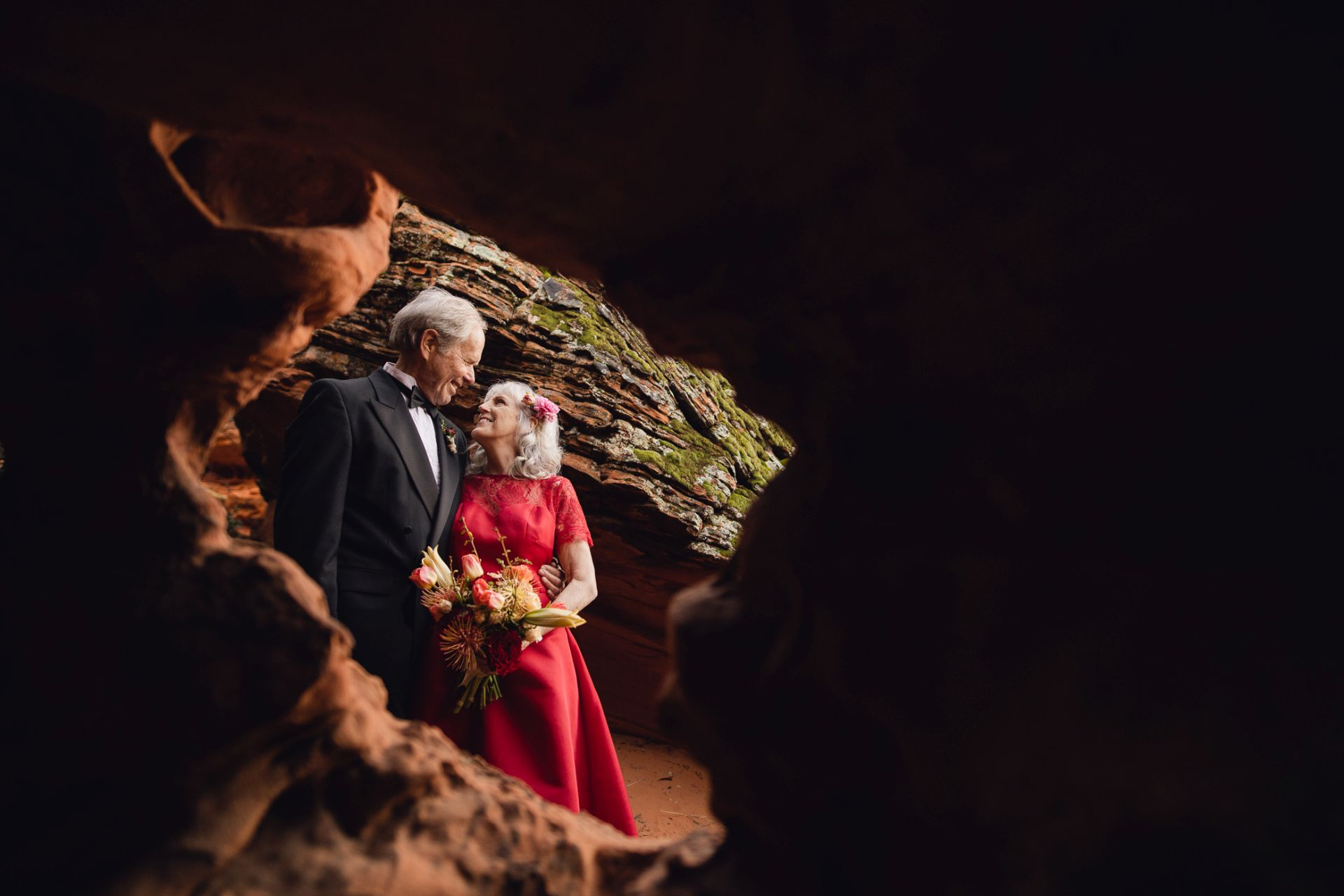 adventure wedding in the utah desert - couple photographed in spectacular cave