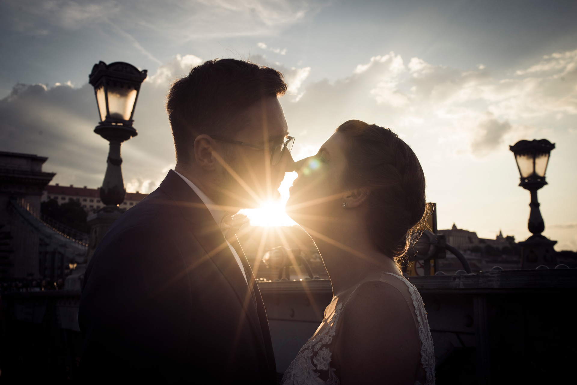 Elopement and honeymoon in Budapest - romantic elopement location in Europe, couple kissing in sunset
