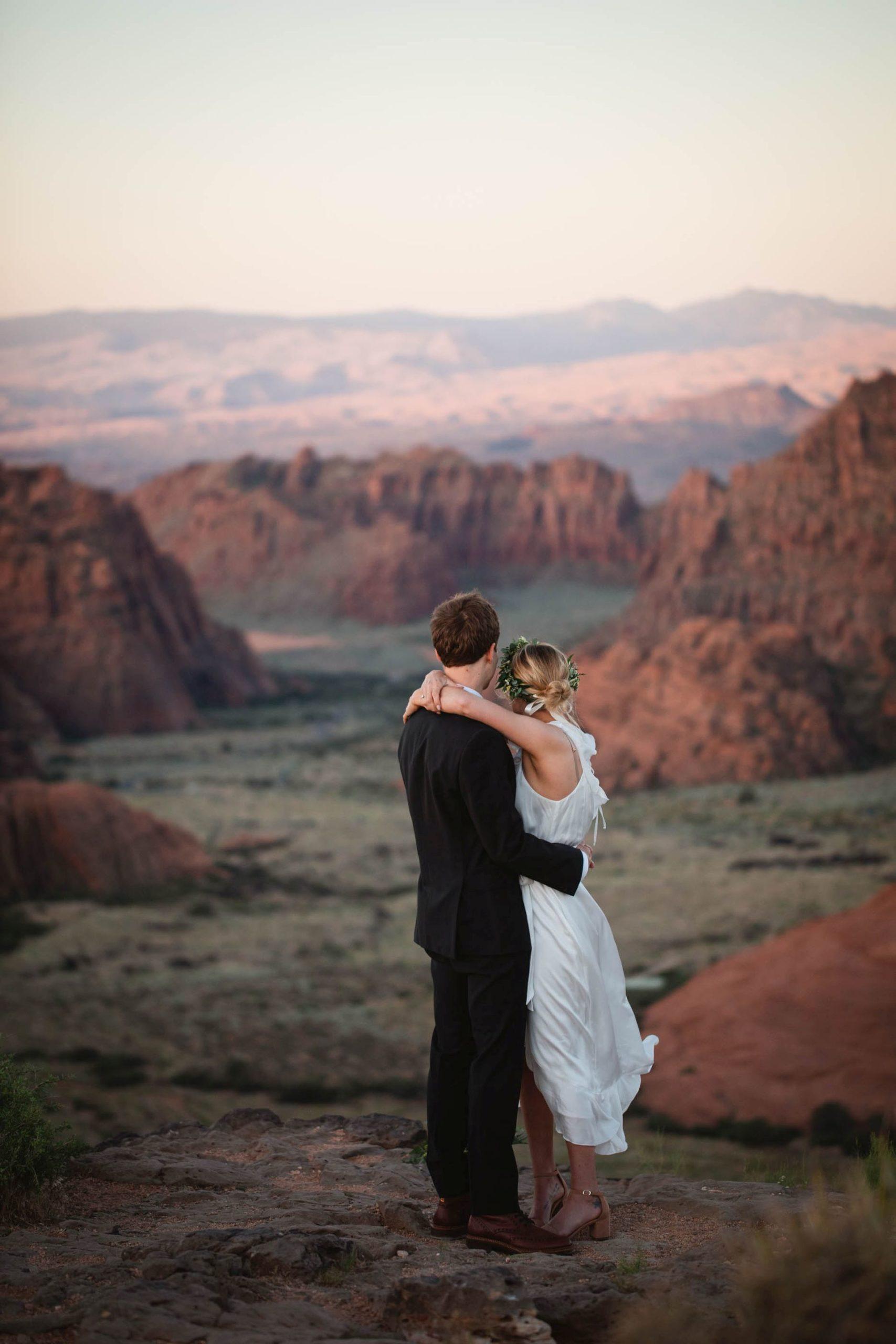 hike-out wedding utah desert - couple in front of desert views at sunset