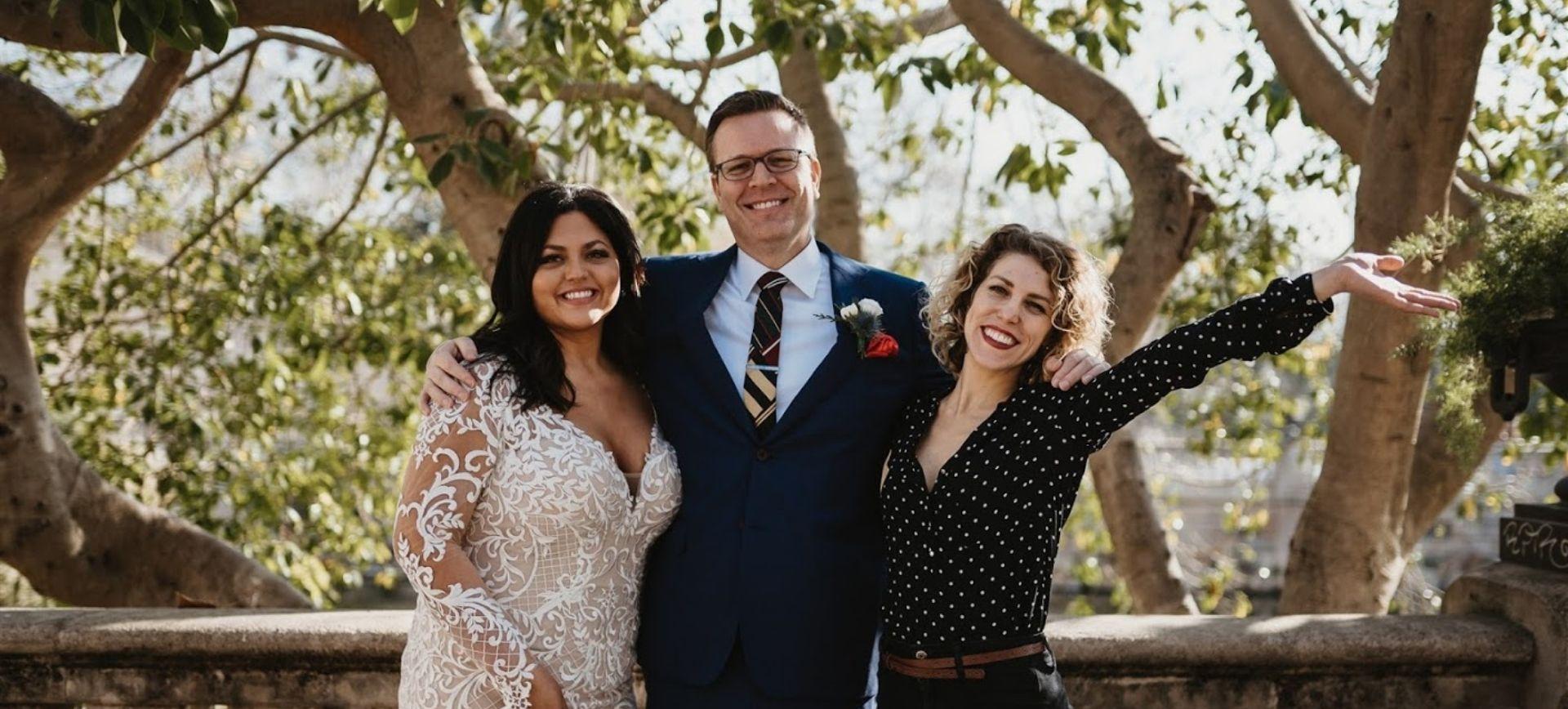 elbride & groom with their elopement planner in barcelona
